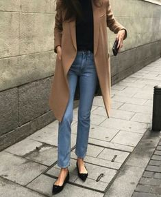 Camel coat and black top with denim. Pointy flats.