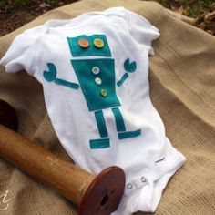 Make these cute onesies for a boy using fabric and buttons. Template included.