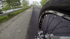 POV Footage of a Guy Riding His Bike over a Bridge's Arch Beam... watching this stressed me out!
