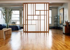 Raydoor, a sliding door system that doesn't use a floor track