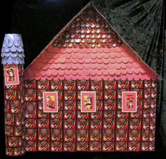 Image #1 of my castle made of cards. It is paper mache with a playing cards covering. I'll take any offer. It stands over 2' and takes up a 3' x 3' space.