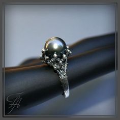 Hey, I found this really awesome Etsy listing at https://www.etsy.com/listing/155389865/black-tahitian-pearl-ring-in-sterling