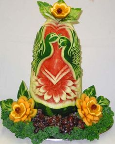 Love Birds Kissing -This master carver will create just about anything you can imagine using the canvas of a watermelon.
