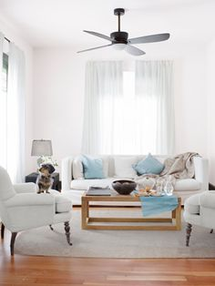 Modern Minimal Living Room    With its rounded arms and turned acacia-wood legs, this linen-upholstered chair from Vagabond Vintage breaks up all of this living room's right angles: Bombast's square-backed sofa, a blocky Indonesian wood coffee table from Pols Potten, even the rectangular linen shade atop a lamp by Barbara Cosgrovez.