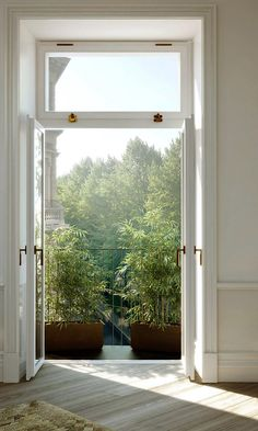 Would love a window like that above my front door...could open when not wanting the door open!