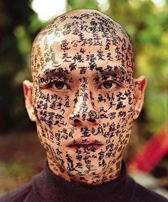 """#artcubeloves 'Family Tree' by #ZhangHuan. Huan invited 3 calligraphers to write texts on his face from early morning until night, he told them what they should write and to always keep a serious attitude when writing the texts. This work was about family and the Spirit of family. In the middle of Huan's forehead the texts mean """"move the Mountain by Fool"""" (Yu King Yi Shan), a story known in China about determination and challenge #artcube"""