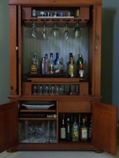 "Make mine a double! Old TV armoire ""tuned"" into a bar."