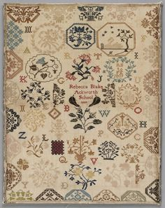 """Sampler with scattered floral and geometric motifs and letters, worked in polychrome yarns in cross stitch, and inscribed, """"Rebecca Blake/Ackworth School/1809."""""""