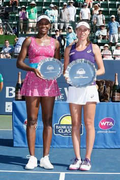 Johanna Konta (right) of Great Britain and Venus Williams of the United States pose for photos after the final during day seven of the Bank of the West Classic at the Stanford University Taube Family Tennis Stadium on July 24, 2016 in Stanford, California. Johanna Konta defeated Venus Williams in the final 7-5, 5-7, 6-2