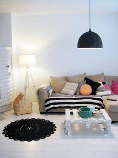 ignore the colours but the concept of different shades of cushions and the black lamp looks cool against the white