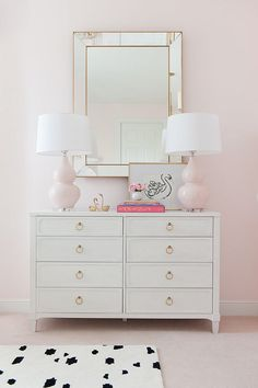 blush lamps, blush walls and carpet with white furniture and touches of gold. Add a black and white rug for contrast and cool