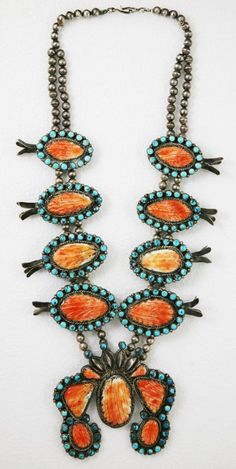 Zuni Silver, Turquoise and Spiny Oyster Squash Blossom Necklace. This and more rare Native American jewelry