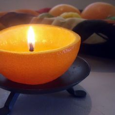 I was so delighted when a friend showed me how to make an all natural citrus fruit candle using only a fresh piece of fruit and a little olive...