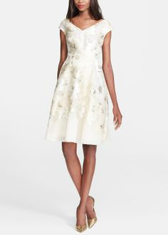 This Lela Rose gold leaf fil coupe floral dress is simply stunning.