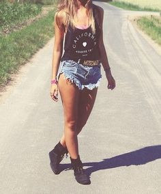 California Love black cropped tank top + distressed and frayed acid wash high waisted shorts + gold moschino belt + short black combat boots