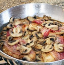 This easy skillet recipe features chicken breasts cooked in the skillet then finished in the oven with slices of bacon and mozzarella cheese. Feel free to use precooked bacon in this dish, and serve with rice or noodles.