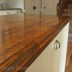creating custom high end butcher block counter tops for cheap, countertops, diy, how to, kitchen design, woodworking projects, Here is our countertops after being routed stained and sealed
