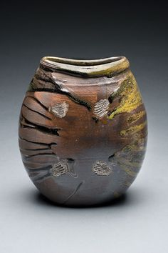 Ken Pincus, Artist, woodfired vase with temmoku glaze & shell mark