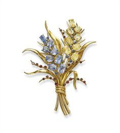 A SAPPHIRE, YELLOW SAPPHIRE AND RUBY 'BOUQUET' CLIP BROOCH, BY VAN CLEEF AND ARPELS  Designed as a spray set with a series of graduated cushion-shaped sapphire and yellow sapphire flowers with circular-cut ruby and sapphire bud details, to the sculpted polished gold leaves, circa 1940, 10.5 cm long
