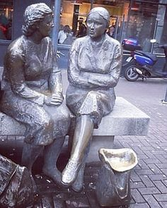 .. Jackie McKenna's 1988 bronze sculpture 'Meeting Place' is a reflection of everyday Dublin city life. This sculpture like many other Dublin sculptures has it's own local nickname - 'The Hags with the Bags'. These two ladys can be found on Lower Liffey Street close to the Ha'penny Bridge, in case you ever need someone to talk to! 😊. (Photo: Irish Nostalgia) . . . . #shoppers #irishwomen #liffeystreet #statue #thehagswiththebags #meetingplace #lovindublin #talking #chat #peopleoftheday… Dublin City, Irish Art, Meeting Place, Bronze Sculpture, City Life, Britain, Reflection, Nostalgia, Bridge