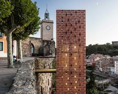 carles enrich wraps 20 meter-high elevator in catalonia with a brick lattice