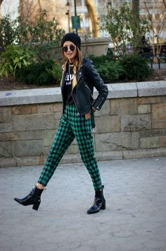 Green tartan trousers teamed with a leather jacket.  She is effortlessly cool x