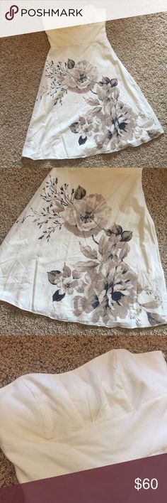 WHBM Ivory Strapless Dress with Flowers Beautiful floral print on the front, fully lined, with boning in the bodice. EUC. Side invisible zipper with hook at the top. Firm on price, as will keep if it doesn't sell. White House Black Market Dresses Strapless