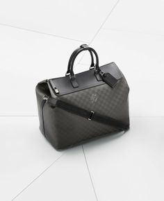 The Louis Vuitton Weekender GM i8 is a large soft travel bag designed to be handheld or carried on the shoulder and is a perfect fit for the boot of the BMW i8. | See more about travel bags, bmw i8 and louis vuitton.