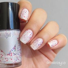 Colorful glitters in a white crelly base