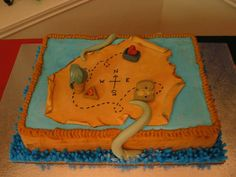 """Pirates of the Caribbean - This was for a Pirates of the Caribbean themed party. The treasure map has a symbol from each movie. The sides of the cake are made to look like wood or the side of a ship. Then we have the water at the bottom and Davy Jones' tenticles coming up over the """"boat"""". Hope you enjoy."""