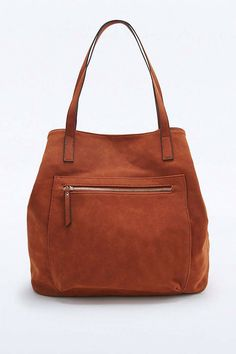 d9be70c2ad8f12 Shop Rust Vegan Suede Traveller Tote Bag at Urban Outfitters today.