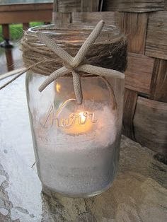 Seaside Inspired - Beach Decor: DIY Starfish Candle Jar.  This same concept could be used with a cylinder vase instead of a mason jar to make it a little more sleek.  Perfect Beach-themed decor.