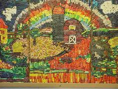 What to do with all of those leftover crayons? Make a Mosaic Mural!  Submitted by Kelli Wilke    This amazing crayon mosaic mural was done about 25 years ago at Kelli's school. That teacher has since retired, but we think the crayons are glued directly to plywood panels with good old Elmer's Glue.. Kelli teaches at Crete Public Schools - Middle School, Crete, Nebraska.