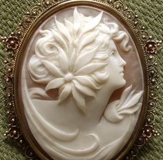Large Victorian Carved Shell Cameo Brooch/Pendant Of A Woman With A Large Flower Blossom In Her Hair, Mounted In A 10k Gold Openwork Filigree Frame