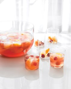 Rose Punch Recipe -- made with sparkling lemonade, Chambord, raspberries, peaches, and, of course, rose wine.