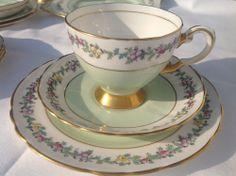 Vintage Tuscan china tea set 6 cups saucers plates. Pale green gilt bone china