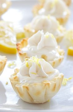 Lightened up lemon cream pie filling served in mini phyllo cups is the perfect bite sized dessert!