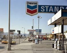 """Stephen Shore (American, born 1947). _Beverly Boulevard and La Brea Avenue, Los Angeles, California, June 21, 1975._ 1975. Chromogenic color print, printed 2013, 17 x 21 3/4"""" (43.2 x 55.2 cm). The Museum of Modern Art, New York. Acquired through the generosity of Thomas and Susan Dunn, 2013"""