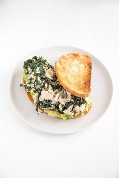 No more boring tuna salad sandwiches for lunch. Bust the monotony with one of these 5 easy ways to make a tastier tuna salad sandwich, including this Kale + Smashed Avocado Tuna Sandwich.