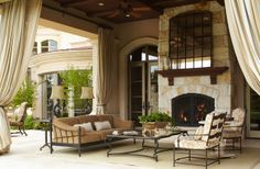 Cozy outdoor living space with large stone fireplace