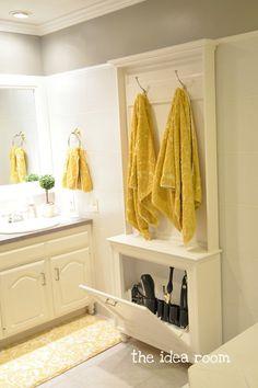Towel rack with hair tool storage cabinet below.  DIY!
