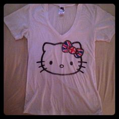 HELLO KITTY v-neck white tee. Size juniors med hello kitty white v neck. Tee w/British flag bow. Size juniors med.  very cute! Worn once and washed. New condition! Hello Kitty Tops