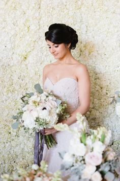 flower wall and bouquet at this winter themed inspired styled shoot and floral workshop