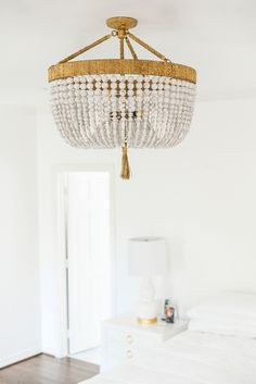 As I mentioned in Tuesday's post, on Monday I finally had all of my light fixtures installed! I don't mean to sound obnoxious, but it's actually crazy how much decorative. Eclectic Chandeliers, Cool Chandeliers, Chandelier Bedroom, Beaded Chandelier, Ro Sham Beaux, Low Ceiling Lighting, Beach Kitchens, Home Office Lighting, Extra Bedroom