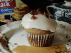 French Toast Cupcake with Maple Frosting and crumbled bacon...oh so good! Guys love it!