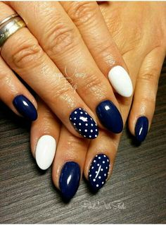 White Enamel nails, black enamel nails, and polka-dot nail designs.