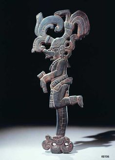 A polished stone scepter in the form of God K, or K'awiil. Note the serpentine leg. Ca. 650-750 AD.