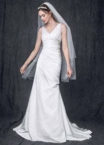 This gorgeous satin sheath wedding dress will showcase your natural beauty for a truly classic  look!  Strapless satin V neck sheath gown features sparkling beaded applique detail at waist.  Ruched bodice helps create a stunning and ultra-flattering silhouette.  Size 0-14. Sweep train.  Ivory available in stores and online.  Woman: Style 9WG3551  Sizes 16W- 26W.   Fully lined. Back zip. Imported polyester. Dry clean. To preserve your wedding dreams, try our ...