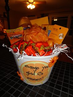 Here is a summer gift idea.  I filled the basket full of lots of orange goodies.  Complete with a card in an orange envelope.  I downloaded the orange clip art from http://www.coleyscorner.com/2012/05/year-end-teacher-gifts.htm.