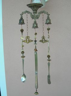 Junk chime...  upside down candelabra turned in to windchime!